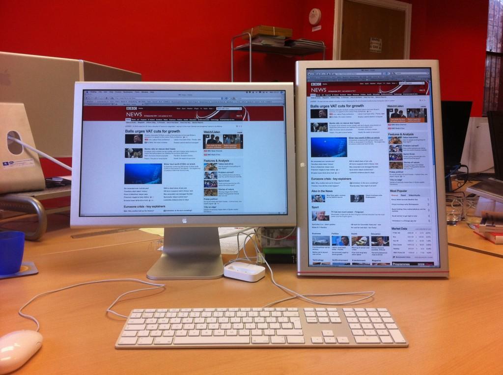 Two Apple studio monitors, one portrait, one landscape